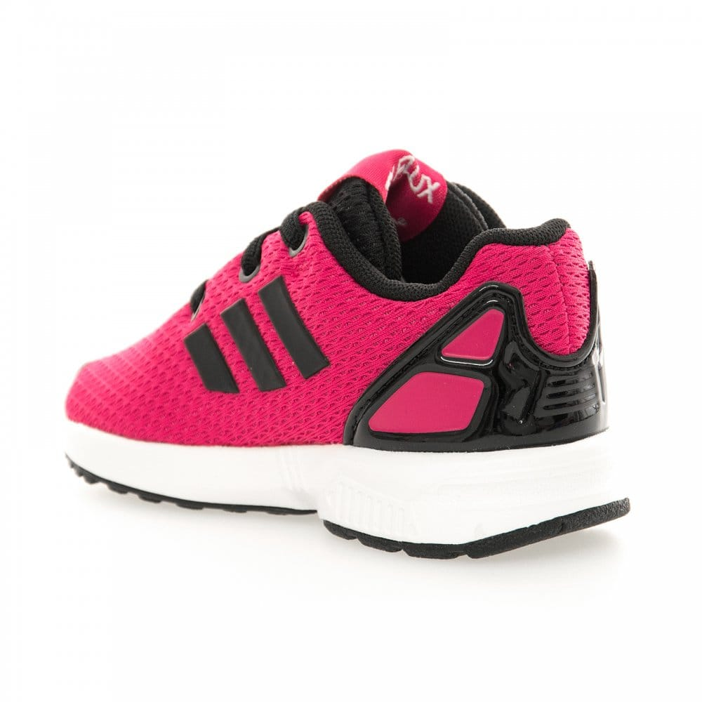 pink and black adidas trainers .