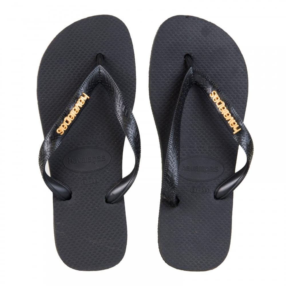 977a7a741bf2fc Havaianas Womens Logo Metallic Flip Flops (Black) - Womens from ...